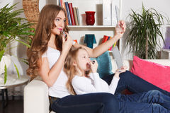 Mother and little girl spending time together Stock Photography