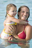 Mother and little girl in swimming pool Royalty Free Stock Images