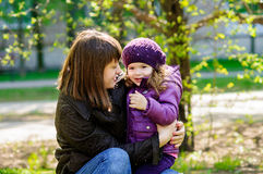 Mother with little girl. Walk in the park Stock Images
