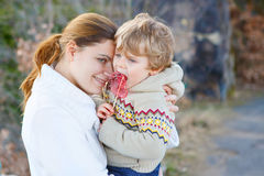 Mother and little kid boy in park or forest, outdoors. stock photos