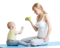 Mother and little kid spending time in gymnastics Royalty Free Stock Image