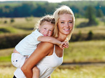 Mother and little pretty girl outdoors. Beautiful Portrait of  mother and little pretty girl outdoors Royalty Free Stock Photos