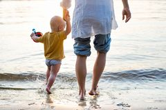 Mother and little son on beach Stock Photos