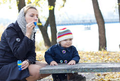 Mother with little son blowing bubbles Stock Image