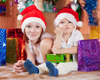Mother and little son with Christmas gifts Royalty Free Stock Image