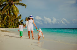 Mother with little son and daughter walk on beach Royalty Free Stock Images