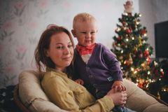 Mother and little son at home near Christmas tree Stock Images