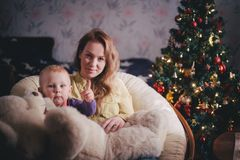 Mother and little son at home near Christmas tree Royalty Free Stock Image