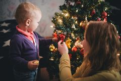 Mother and little son at home near Christmas tree Stock Image