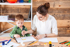 Mother and little son painting together in art school Stock Image
