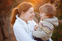 Mother and little son in park or forest, outdoors. Hugging and having fun together. Happy toddler boy and young mum, kid and women playing Stock Photo
