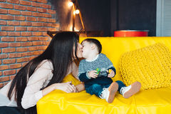 Mother and little son play at home stock images