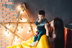 Mother and little son play at home royalty free stock image