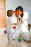 Mother and little son playing at home Royalty Free Stock Images