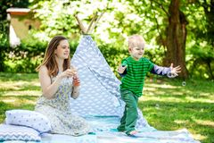 Mother and little son playing in the park. Bubbles. The concept. Of lifestyle and childhood Royalty Free Stock Photos
