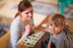 Mother and little son playing together education card game for c Royalty Free Stock Image