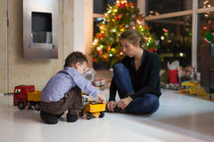 Mother and little son playing with toy car on Royalty Free Stock Photo