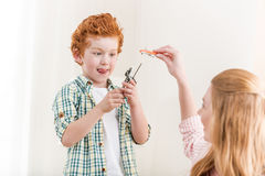 Mother and little son playing with toys at home, family fun. At home concept Stock Photos