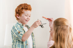 Mother and little son playing with toys at home, family fun Royalty Free Stock Image