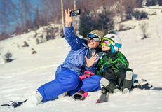 Mother and little son selfie on the ski slope resort Stock Images