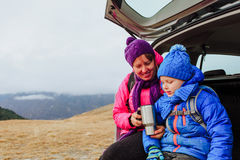 Mother and little son travel by car in mountains Royalty Free Stock Image
