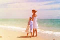 Mother with little son walking on the beach Stock Images