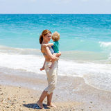 Mother and little toddler boy having fun on beach stock images