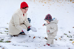 Mother and little toddler boy  on winter day Royalty Free Stock Images