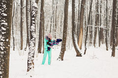 Mother and little toddler girl walking in the winter forest and having fun with snow. Family enjoying winter. Christmas Royalty Free Stock Photo