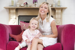 Mother in living room with baby Stock Photos