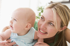 Mother in living room with baby Royalty Free Stock Image