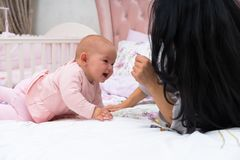 Mother is playing with her baby child. royalty free stock photography