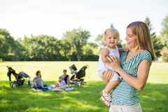 Mother Looking At Cute Daughter In Park Royalty Free Stock Image
