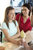 Mother Looking At Daughter Receiving Ice Cream Cone From Waiter Stock Image