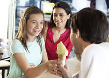 Mother Looking At Daughter Receiving Ice Cream From Waiter Royalty Free Stock Image