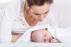 Mother looking at her sleeping baby Stock Photography