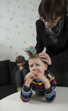Mother looking for lice on youngsters head Stock Photo