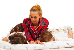 Mother looking at sleeping kids Royalty Free Stock Images