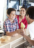 Mother Looking At Son Receiving Ice Cream From Waiter Royalty Free Stock Photography