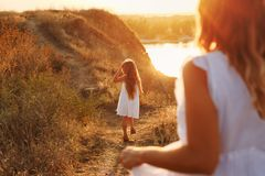 Mother and daughter on a walk in the countryside. stock photography