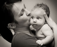 Mother love. Portrait with her baby girl in sepia tone Royalty Free Stock Image