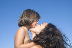 Mother love. On blue sky backgrond and copyspace Royalty Free Stock Images