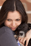 Mother Love. Young woman hugging a puppy Royalty Free Stock Photography