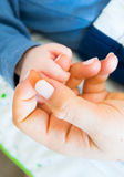 Mother love. Baby holding hand of mother Stock Photography