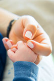 Mother love. Baby holding hand of mother Royalty Free Stock Photo