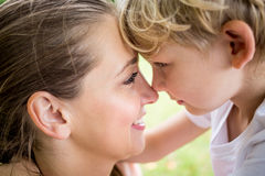 Mother love concept. With women head to head with her child Stock Photos