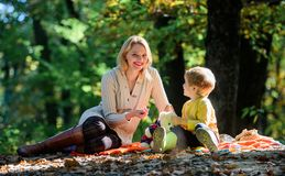 Mother love her small boy child. Sunny weather. Healthy food. Spring mood. Happy family day. Family picnic. Mothers day. Happy son with mother relax in autumn stock image