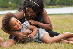 Mother loves her little girl. Pregnant mother and her daughter are having fun stock images