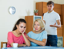 Mother-in-low comforting girl after quarrel with husband Stock Images