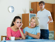 Mother-in-low comforting girl after quarrel with husband Royalty Free Stock Photos